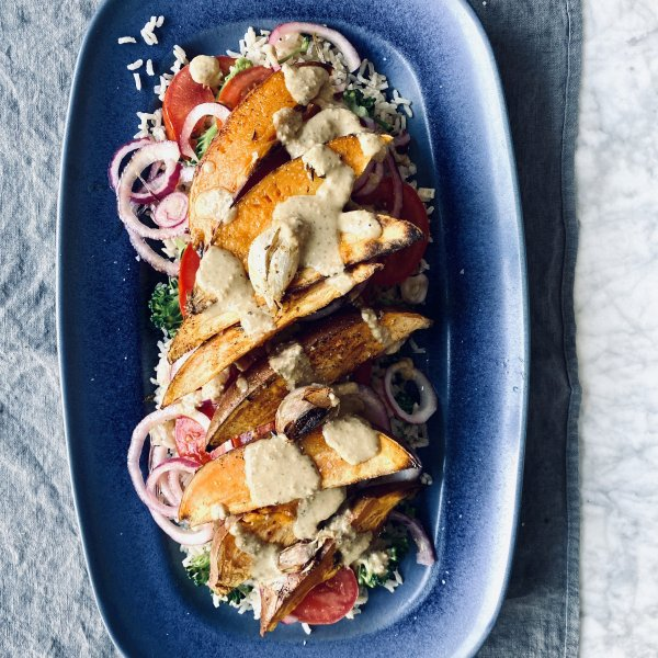 Sweet potato wedges with tomato, onion and brown rice salad