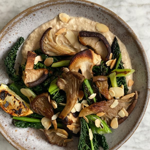 Crispy mushrooms with creamy cannellini beans, greens and griddled limes